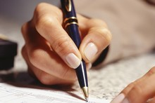 Gill South had to change 'the habits of a lifetime' by re-learning how to hold a pen to cut down the pain she was feeling in her hand. Photo / Thinkstock