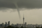 A waterspout seen over Auckland city today, viewed from Northcote. Photo / Christine Keller Smith