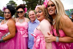 Prime Minister John Key with the ladies during the Big Gay Out. Photo / Dean Purcell