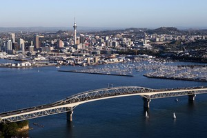 The Auckland Harbour Bridge crossing will simply not be enough by 2040, says a new book on the city. Photo / Supplied