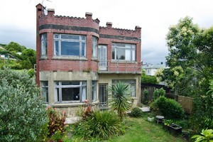 This Mt Eden castle, divided into two flats, needs a complete renovation. Photo / Supplied