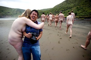 Photographer Binh Trinh works with 35 nude models during a group shoot at Bethells Beach yesterday. Photo / Dean Purcell