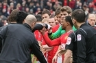 Luis Suarez of Liverpool refuses to shake the hand of Patrice Evra of Manchester United. Photo / Getty Images