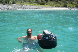 Manuel Scott from West Auckland bringing rubbish, including the plastic barrel, back to his boat moored off Whangatupere Bay, Northland. Photo / Supplied