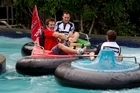 Crusaders captain Richie McCaw (centre) finds himself in a new battle of tactics with referees Glen Jackson and Chris Pollock in the bumper boats at Rainbows End. Photo / Brett Phibbs