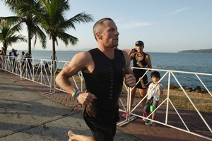 Lance Armstrong competed in the Panama half ironman. Photo / AP