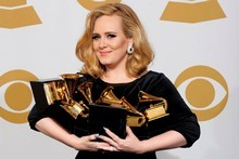 Adele poses backstage with her six awards at the 54th annual Grammy Awards. Photo / AP