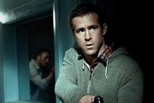 He's behind you! Ryan Reynolds lowers his sights in Safe House while below Jason Statham takes aim in Killer Elite. Photo / Supplied