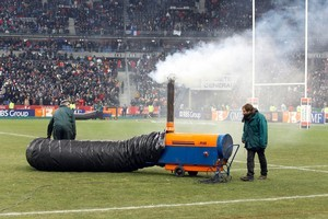 Workers used a heater machine prior to the Six Nations rugby union match between France and Ireland. The game was called off due to freezing weather. Photo / AP