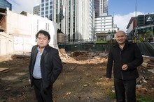 The Chow brothers on the site of the proposed high rise brothel in Auckland. Photo / Paul Estcourt