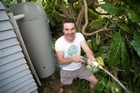 Justin Newcombe's watering method of choice for his garden is the humble hose. Photo / Richard Robinson