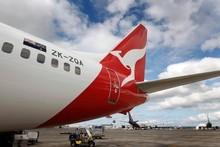 Qantas' cuts follow a 51.6 per cent drop in profit be