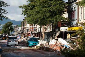 Colombo St suffered heavy damage as building facades collapsed onto the street. Cordons did little to protect people. Photo / Simon Baker