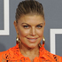 Black Eyed Peas frontwoman, Fergie, has chosen a gorgeous orange lace gown. But a slip wouldn't go astray. Photo / AP
