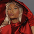 The Quirky: Nicki Minaj looked solemn in this beaded scarlet cloak. Photo / AP