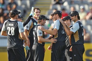 New Zealand players celebrate a wicket in the opening Twenty20 clash against Zimbabwe. Photo / Getty Images