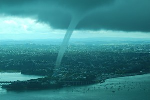 The waterspouts that formed over the North Shore and Waitemata Harbour near the CDB were described as dark, spiralling and 'menacing' and unleashed a deluge of messages on Twitter. Photo / David Simonaire