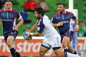 Piri Weepu passes the ball during the Blues pre-season match against the Rebels. Photo / Getty Images