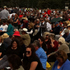 Crowds watch the ceremony at Hagley Park. Photo / Hayden Donnell