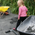 The kids help to clean up after liquefaction. Photo / Supplied