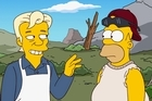 Homer and Marge Simpson meet WikiLeaks founder Julian Assange in the 500th episode of The Simpsons. Photo / AP