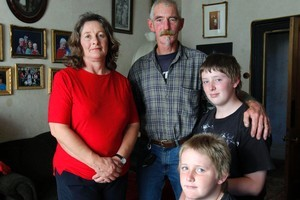 Julie and Dennis Jeffries with sons Jake (13) and Jesse (10) front. A late payment left their house uninsured. Photo / Simon Baker