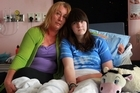 Theresa Jeffries and Crystal, who had her 15th birthday in hospital. Photo / Doug Sherring