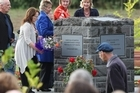 Christchurch quake victims attend the dedication and unveiling of a memorial for the unidentified and unfound victims of the earthquake, one day before the anniversary of the event. Photo / Greg Bowker