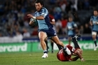Blues centre Rene Ranger on the charge against the Crusaders last night. Photo / Dean Purcell
