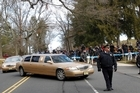 A long line of limos follow the hearse carrying the body of Whitney Houston arrives at Fairview Cemetery for her burial in Westfield, New Jersey. Photo / AP