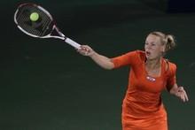 Caroline Wozniacki returns the ball to Julia Goerges during their semifinal match in Dubai. Photo / Getty Images