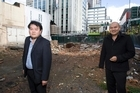 Brothers John (left) and Michael Chow on the Auckland CBD site of the old Palace Hotel.  Photo / Paul Estcourt