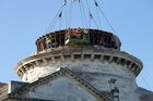 Engineers prepare the internal pressed copper dome from the basilica. Photo / Simon Baker