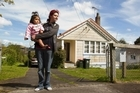 File photo of Angelica Seamer and her daughter Mereama in front of their  Glen Innes house. She will be moved from the house to another rental property to make way for the Housing Corp Re-Developement plan. Photo / NZ Herald
