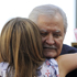 Jennifer Aniston is embraced by her father, actor John Aniston, after receiving her star. Photo / AP