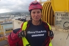 Seven Greenpeace protesters, including Hollywood star Lucy Lawless, clambered onto an Arctic-bound oil drilling vessel and scaled its 53-metre tower at Port Taranaki this morning. Photo / Greenpeace