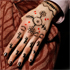 A close up of the design on the hand of a model as she displays a creation by designer Vivienne Westwood. Photo / AP