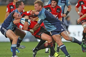 Michael Hobbs of the Blues (L) makes a high tackle on Ryan Crotty of the Crusaders. Photo / Getty Images