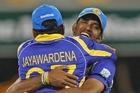 Sachintra Senanayake, right, of Sri Lanka celebrates with teammate Mahela Jayawardena afer catching India's Vinay Kumar. Photo / Getty Images