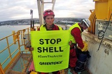 Lucy Lawless and Greenpeace activists protesting on board a Shell-contracted oil drillship in Port Taranaki. Photo / Greenpeace