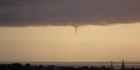 Photos: Funnel cloud over Auckland