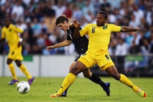 Marco Rojas of the All Whites competes with Jermaine Taylor of Jamaica for the ball. Photo / Getty Images