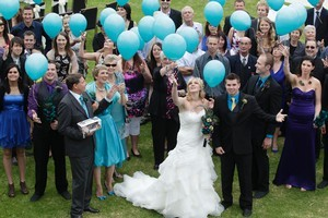 Balloons are released in memory of Christie Marceau at her sister Heather's wedding to Luke Mellor. Her father, Brian (left), holds her ashes. Photo / Richard Robinson