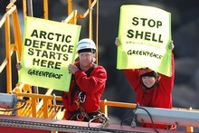 Actor Lucy Lawless and a Greenpeace New Zealand activists protest to stop a Shell-contracted drillship from departing Port Taranaki for the remote Arctic. Photo / Supplied