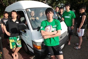 Shota Takemoto, captain of the Japan Touch Rugby Association development team, with teammates whose belongings were stolen. Photo / Richard Robinson
