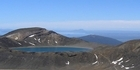 Trampers take on the Tongariro Crossing, where the weather can switch its character from friend to foe in minutes. Photo / Supplied