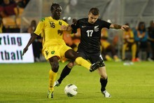 Jamaica's Troy Smith vies for the ball with Kosta Barbarouses of the All Whites. Photo / Steven McNicholl 