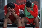 Bahrain players wallow in grief after winning 10-0 against Indonesia. The Middle Eastern nation - trumped by the All Whites in 2009 - have been knocked out of qualifying for the World Cup after a 2-2 tie between Iran and Qatar. Photo / AP