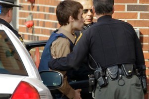 T.J. Lane, a suspect in Monday's shooting of five students at Chardon High School is taken into juvenile court. Photo / AP