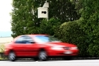 The total of 63,396 offences detected by fixed speed cameras last year was well down on the 105,403 issued in the year to June 30, 2010. Photo / Martin Sykes